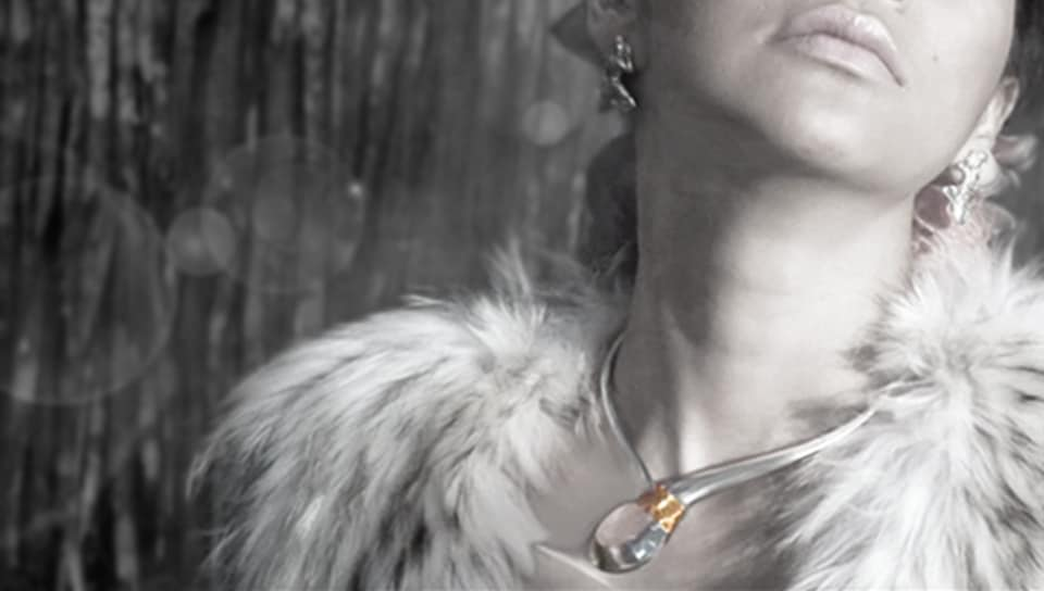 Photo of a model wearing a Gold and SIlver Crystal Tork Necklace for Her World Magazine